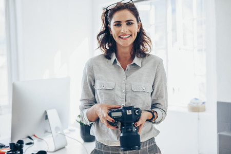 Attractive young woman photographer
