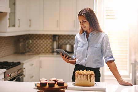Female chef with tablet pc in kitchen