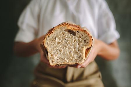 Female baker with fresh bread