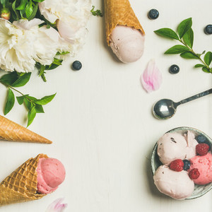 Flat lay of ice cream scoops and peonies  square crop
