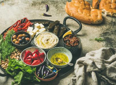 Mediterranean meze starter fingerfood platter in tray  selective focus