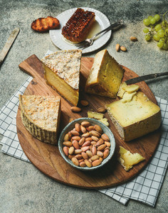 Cheese platter with cheese assortment and snacks