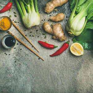 Flat lay of Asian cuisine ingredients over concrete background  square crop