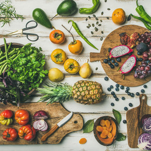 Helathy vegan food cooking background with uncooked fruites and vegetables