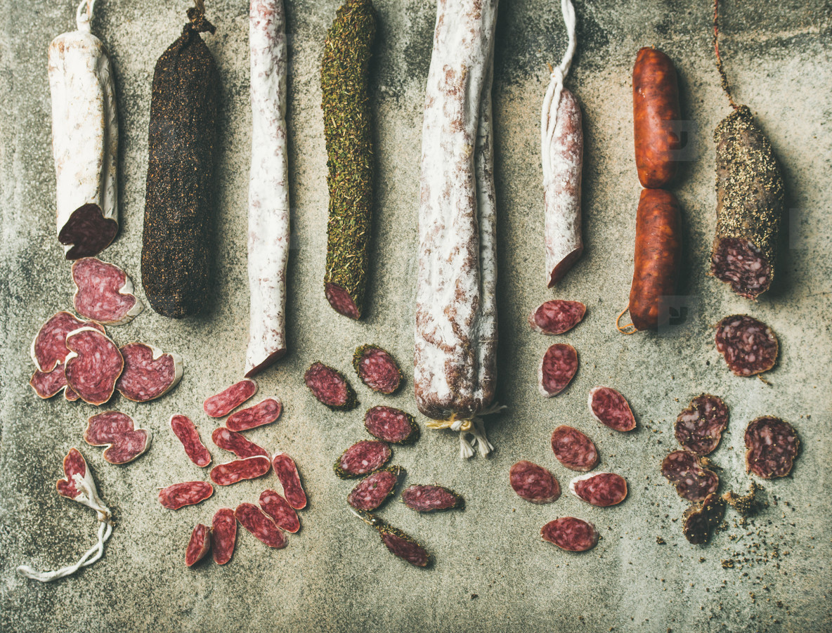 Variety of Spanish or Italian cured sausages cut in slices