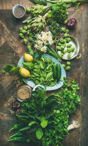 Spring healthy vegan food cooking ingredients wooden background vertical composition