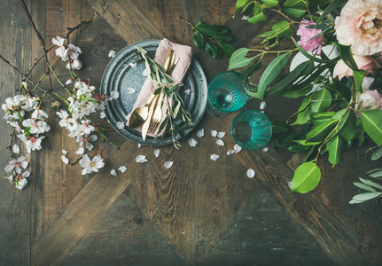 Flat lay of Table setting with almond blossom flowers and peonies