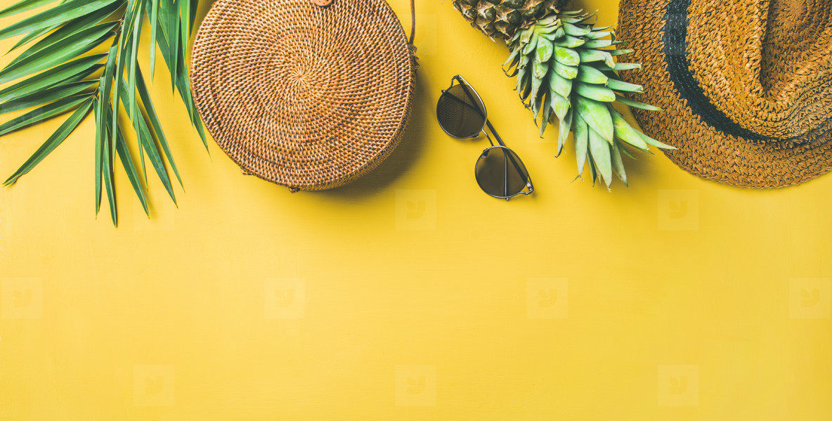 Colorful summer female fashion outfit over yellow background  wide composition