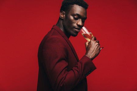 Sophisticated man having champagne at party