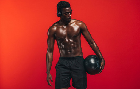Fit young man with medicine ball