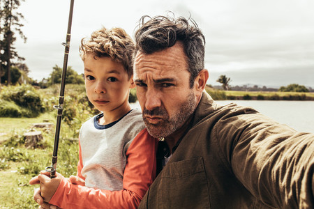 Portrait of father and son out for fishing