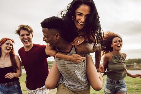 Smiling group of friends enjoying on weekend