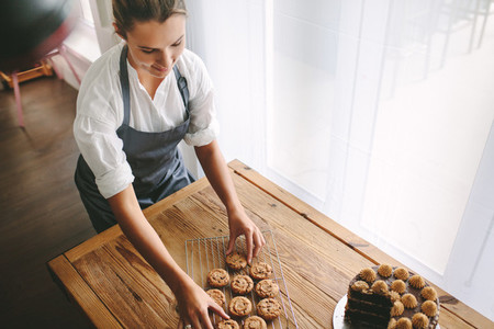 Female pastry chef preparing cookies