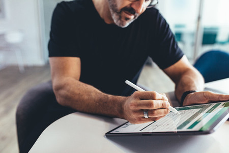 Businessman checking financial report