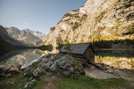 Covered pier over a german lake among mountains on sunset