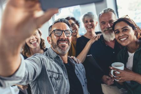 Group selfie in office