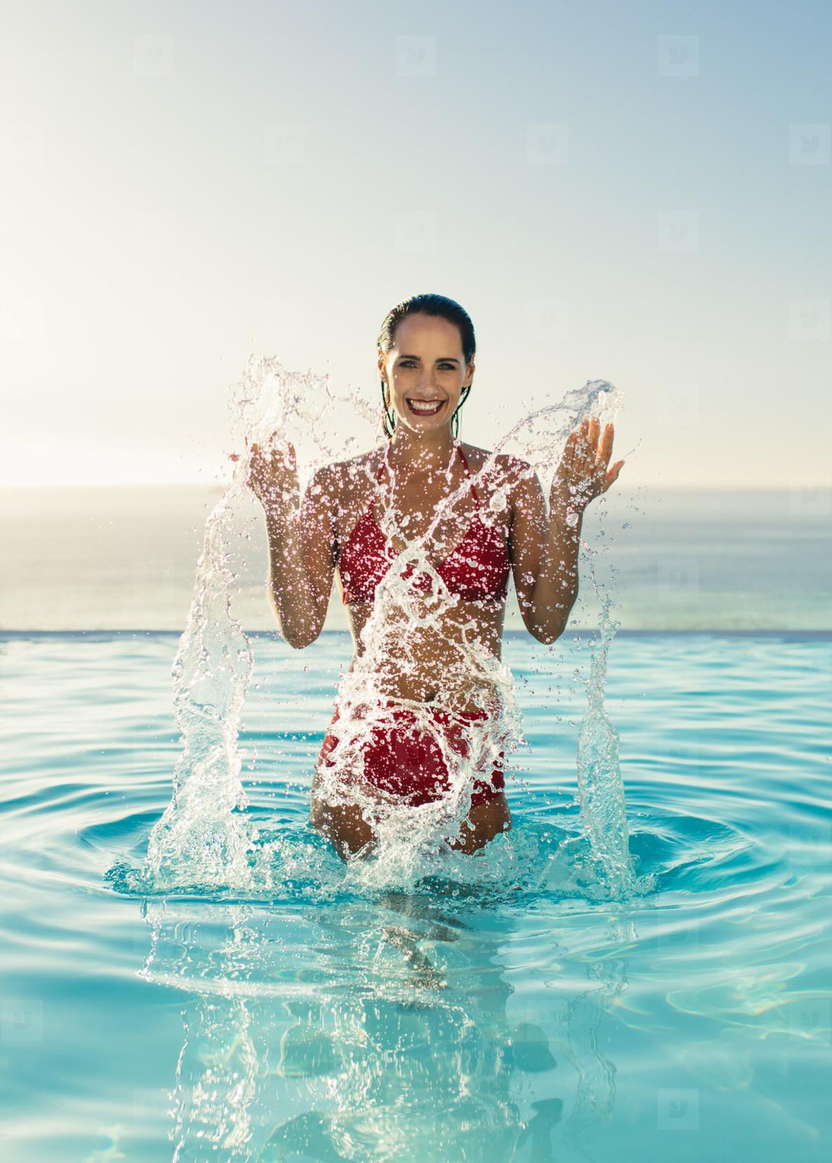 ad88fe87d51 Photos - Woman having fun in infinity pool - YouWorkForThem