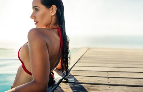 Woman in the pool enjoying the sun