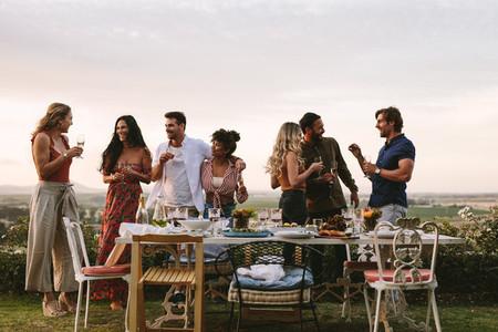 Millennials enjoying dinner party outdoors