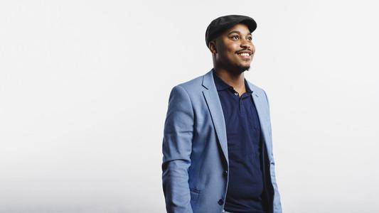 Smiling businessman in cap