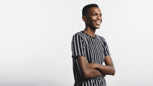 Smiling african man with arms crossed