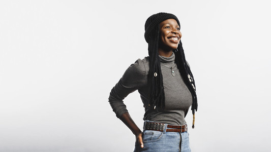 Smiling african female with long dreadlocks