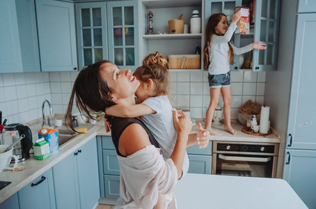 Happy family having fun in the kitchen