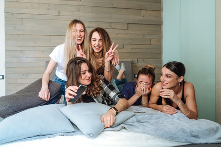 five girls on the bed in the bedroom
