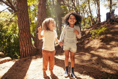 Smiling girls having fun in forest