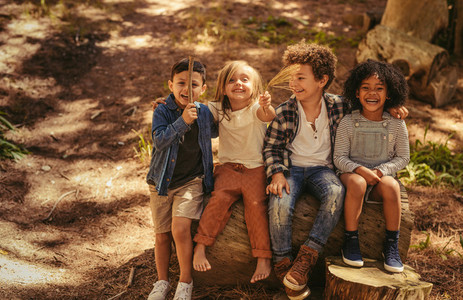 Cute kids outdoor enjoying nature