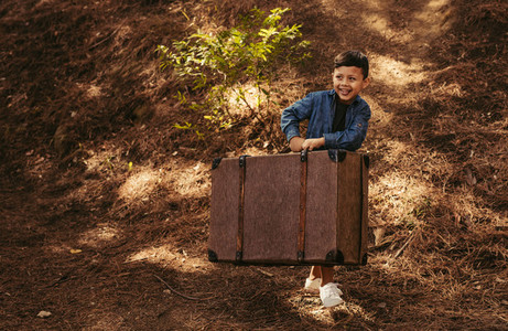 Boy pretending to be going on vacation