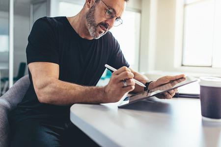 Male entrepreneur checking emails