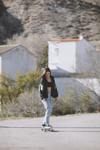 Girl with her skate on a town road