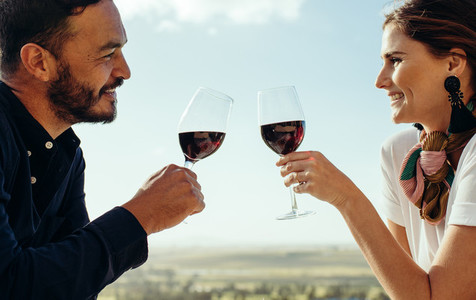 Close up of a romantic couple on wine date
