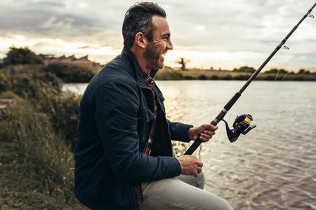 Man enjoying fishing near a lake