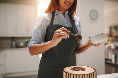 Chef preparing tasty chocolate cake
