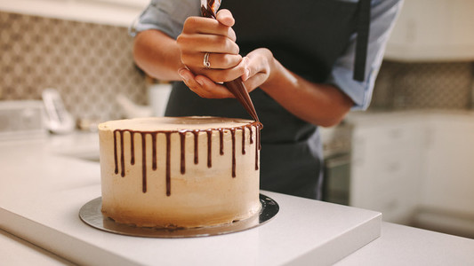 Pastry chef decorating a cake