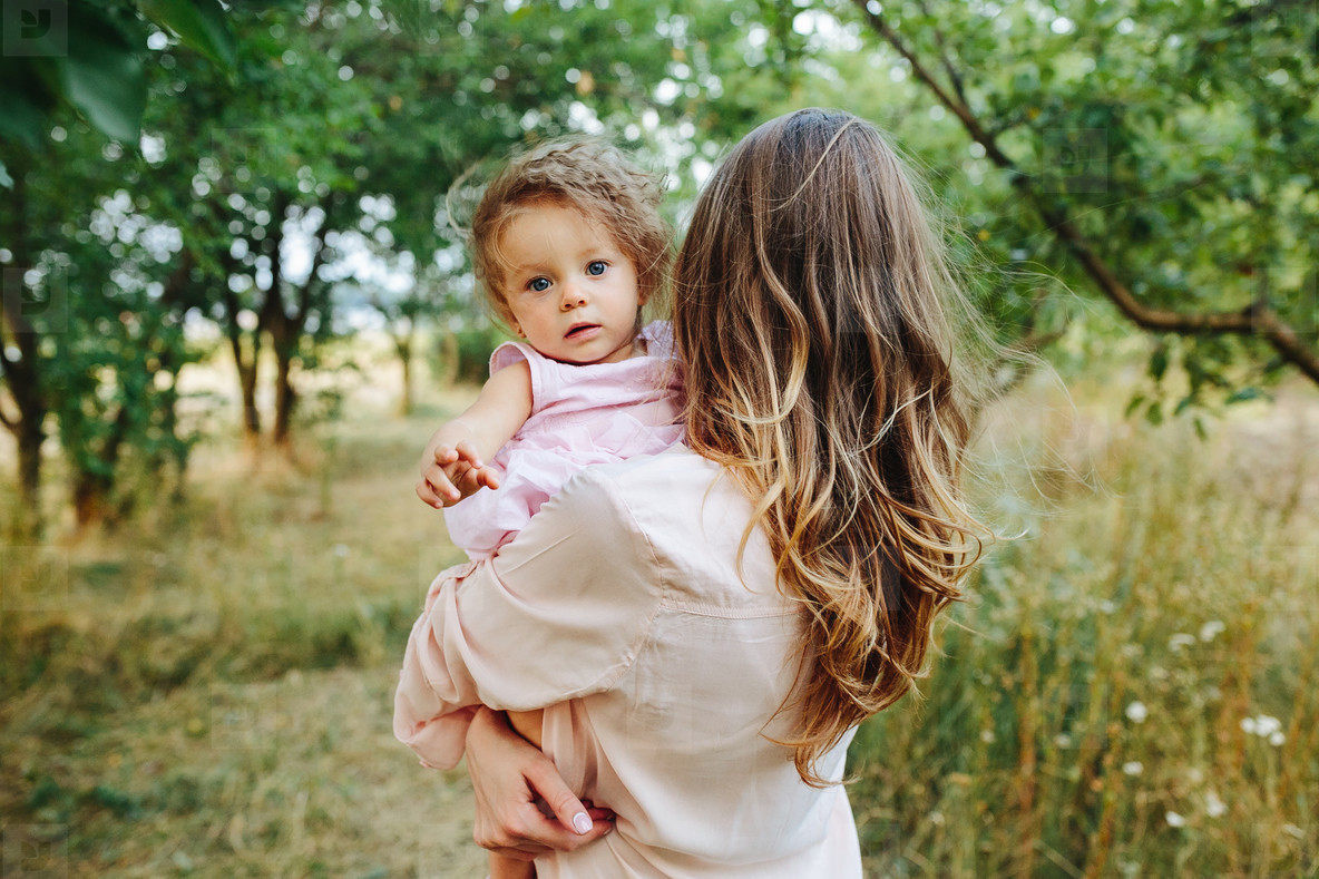 mother and daughter together outdoors