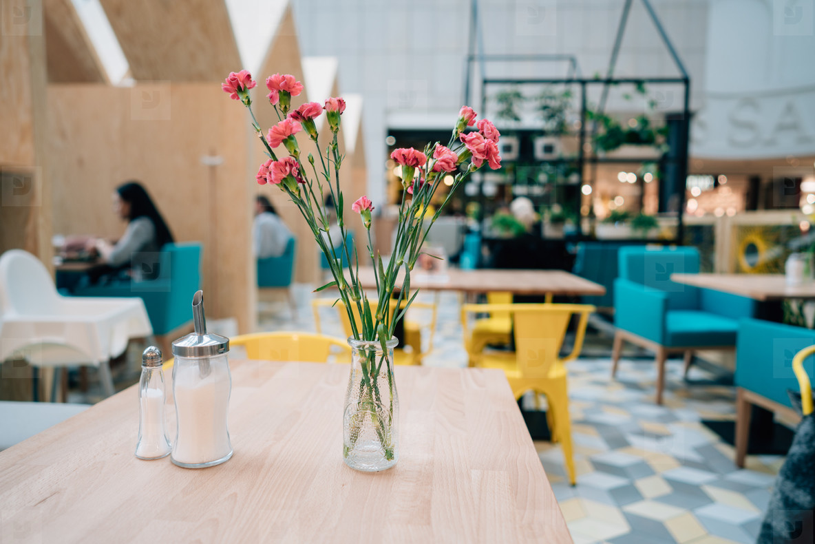 Blur restaurant  on the table is a flower