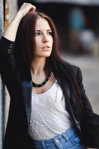 Beautiful female model posing against the wall