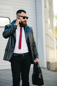 handsome man in a suit talking on the phone