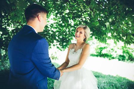 bride and groom dancing in nature
