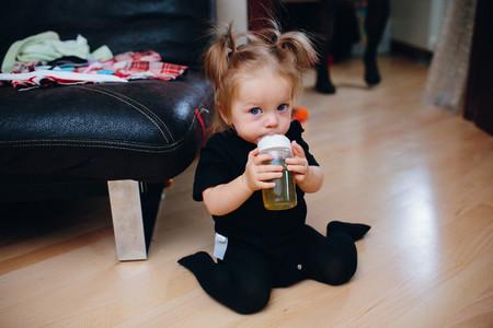 Sweet baby girl sitting on the floor