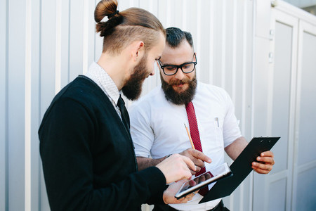 Two businessmen discussing something