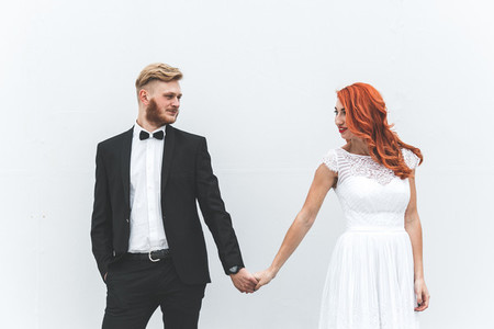 Wedding couple on a background of whitewall