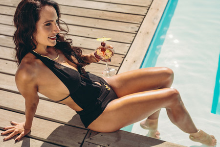 Woman relaxing at the poolside