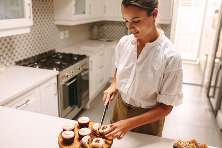 Confectioner making delicious pastry