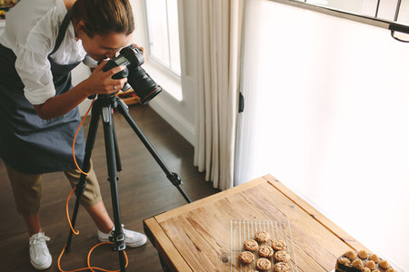 Chef taking pictures of dessert