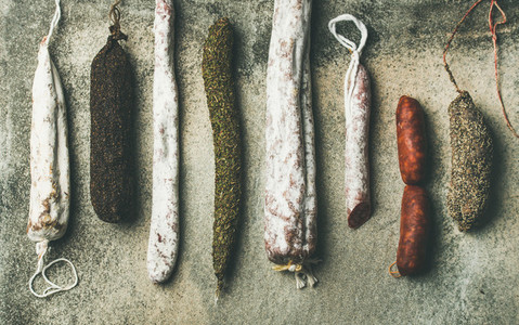 Flat lay of variety of Spanish or Italian cured meat sausages