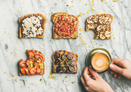 Healthy breakfast with wholegrain toasts   coffee over light marble background